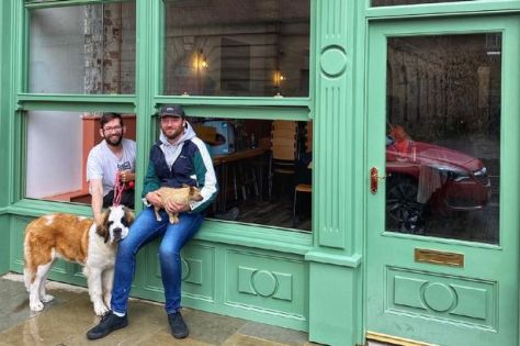 Owners Robert Gomm, 36 and Ryan Green, 32 outside the very dog friendly Upside Down coffee shop