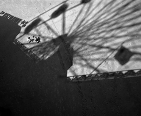 Two children play innocently in the shadow of the big wheel, Blackpool