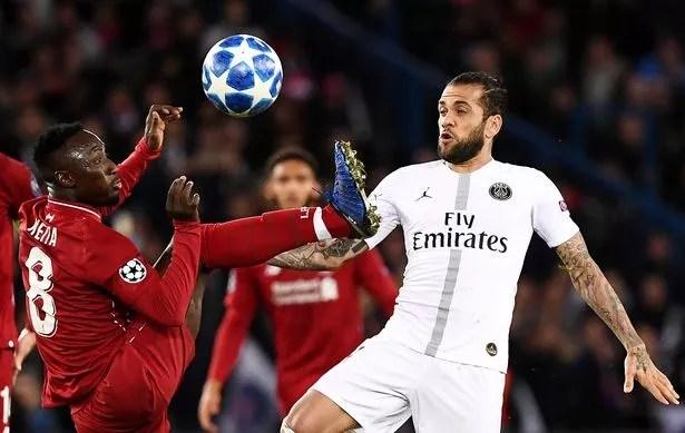 Dani Alves of Paris Saint-Germain vies with Naby Keita of Liverpool
