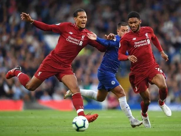 Virgil van Dijk and Joe Gomez of Liverpool combine to block out Eden Hazard