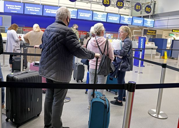 Passengers ready to board one of the first flights to Portugal