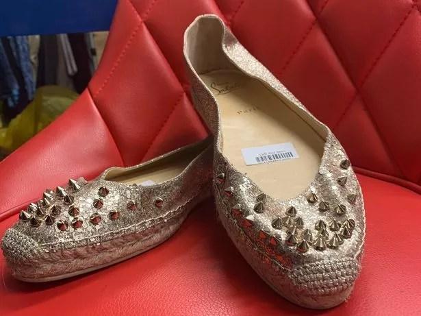 Louboutin shoes in Oxfam, Chorlton