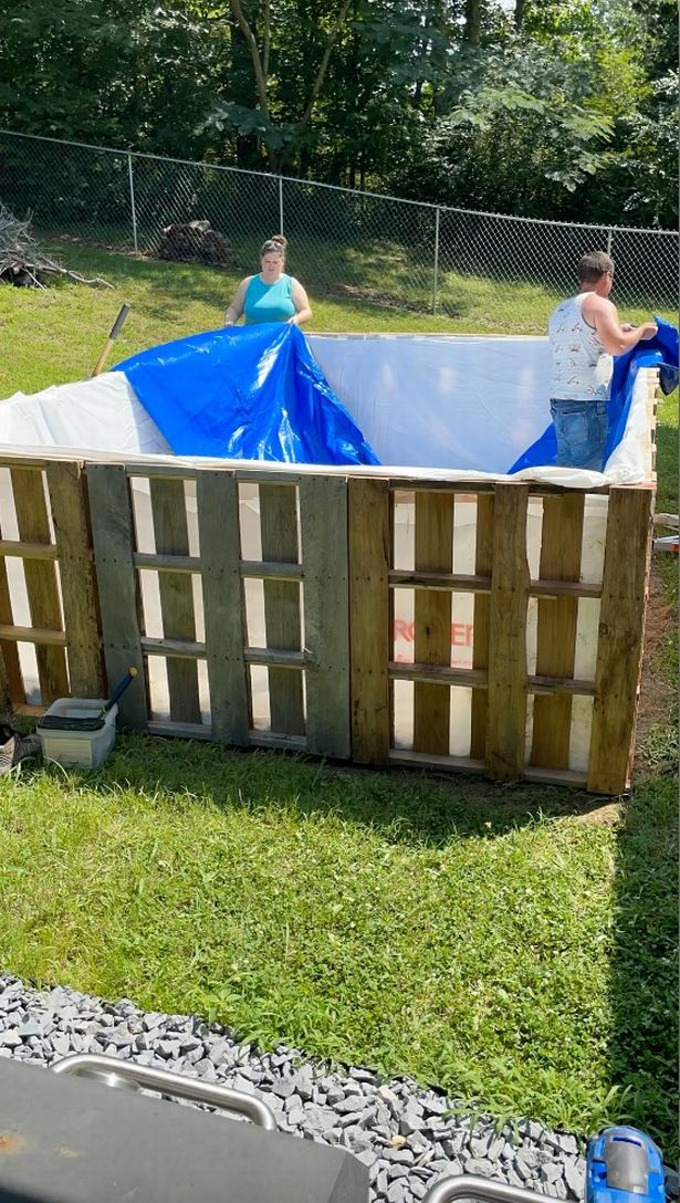Caleb is building a swimming pool out of wooden planks.