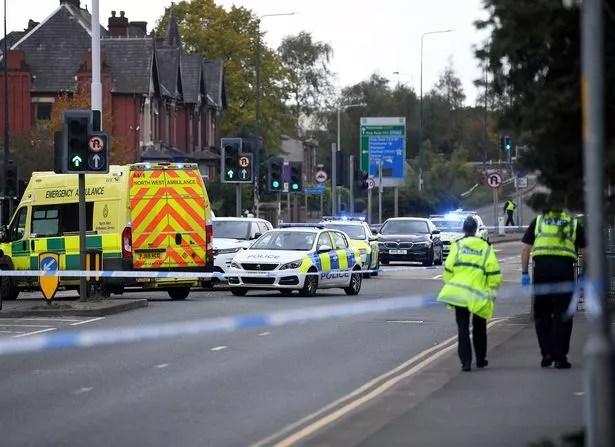 Emergency services at a crime scene on Ashton-Under-Lyne, Manchester Rd.  14 October 2021