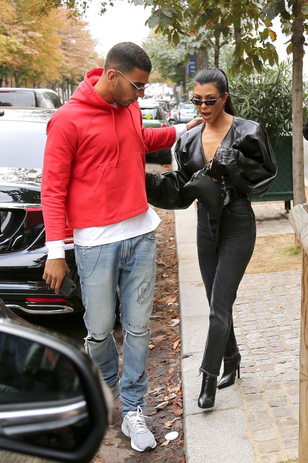Kourtney Kardashian can't stop grinning as she steps out ...