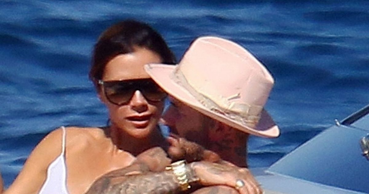 David Beckham Showers Victoria With Kisses In Public