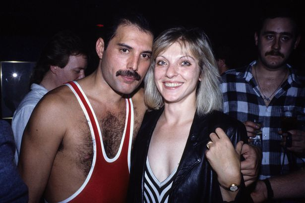 Mary Austin and Freddie Mercury posing for a picture at his 38th birthday after performing at Wembley Arena