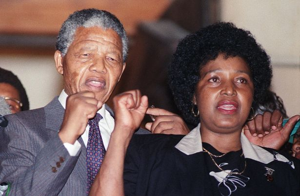 Nelson Mandela and then-wife Winnie are seen raising their fists on February 11, 1990