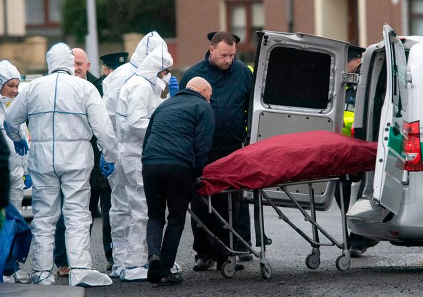 Gardai remove the grisly remains from the scene