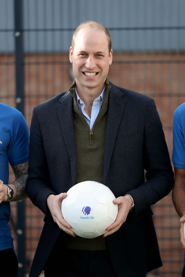 Prince William, Duke of Cambridge poses with players of Everton F.C. during his visit Everton Football Club's official charity Everton in the Community as part of the Heads Up campaign on January 30, 2020