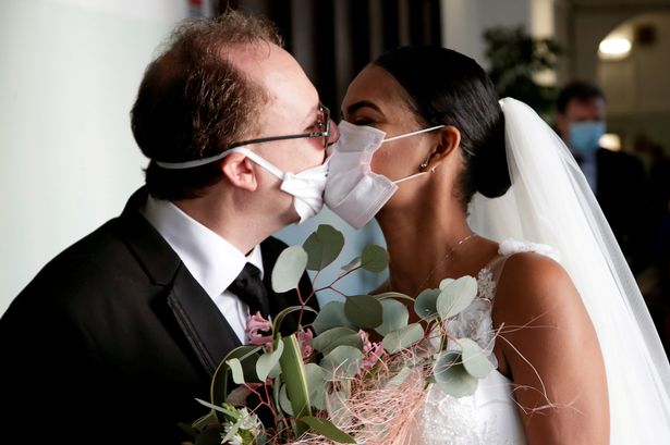 Coronavirus: Italian newlyweds kiss through face masks as ...