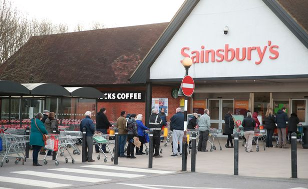 People queuing outside Sainsburys in Guildford