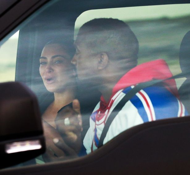 0 PAY PREMIUM EXCLUSIVE Kim Kardashian appears to be crying during what looks to be a heated argument wi