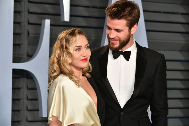 0 FILE Miley Cyrus Liam Hemsworth Separate 2018 Vanity Fair Oscar Party Hosted By Radhika Jones Ar