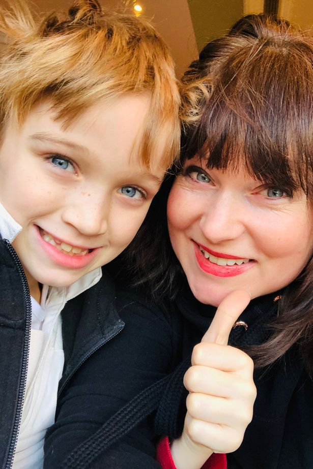 Esther Stanhope cuddles up to son Truman, 8