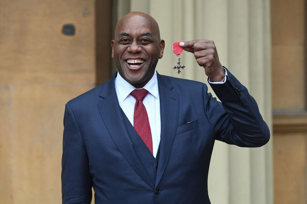 Ainsley with his MBE at Buckingham Palace