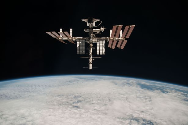 The International Space Station and the docked space shuttle Endeavour orbit Earth during Endeavour's final sortie on May 23, 2011