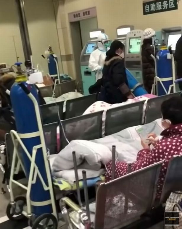 Coronavirus patients lay in a hospital waiting room in Wuhan, China