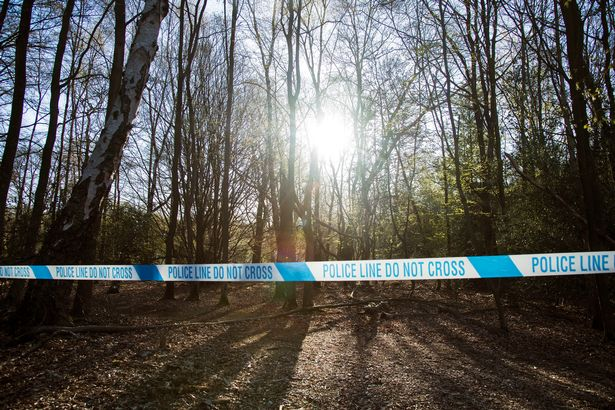 Police tape surrounds Wake Valley pond in Epping Forest following the discovery of a man's body