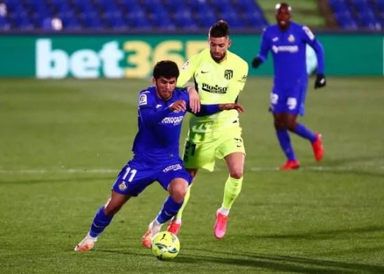 Carles Alena (L) is on loan at Getafe who wants to keep him
