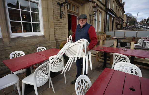 Steve Turner putting out the chairs at the Tubbs of Colne