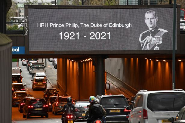 A tribute to Prince Philip after his death is displayed a screen at Euston Underpass in London