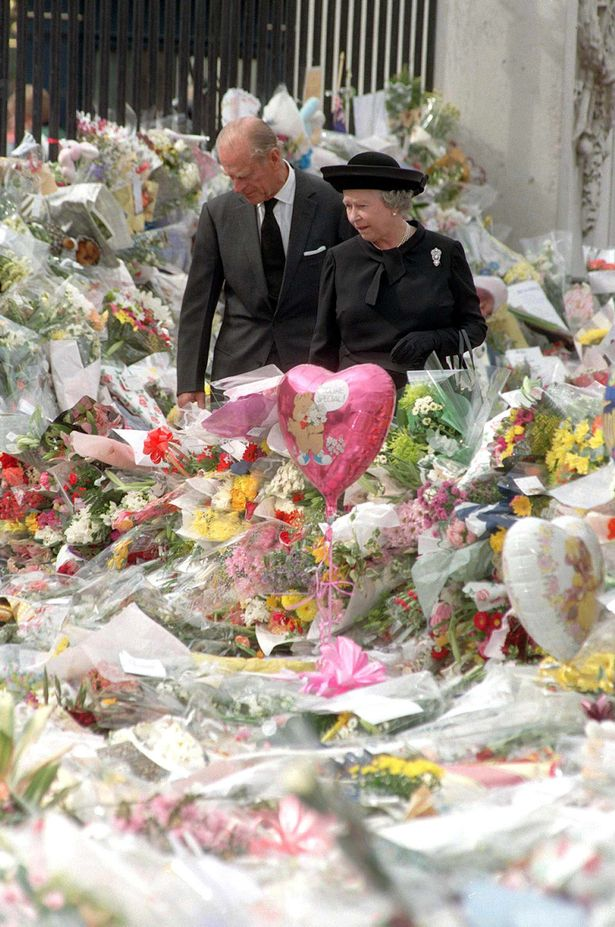 Philip and the Queen view the sea of floral tributes to Princess Diana after her death