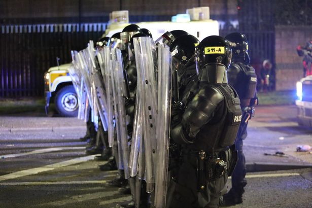 Police in riot gear on Friday used water cannons to disperse rioters