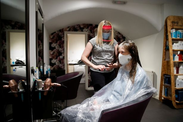 Kelly Boad, owner of Hair & Beauty Gallery, gives Sue Butcher a haircut