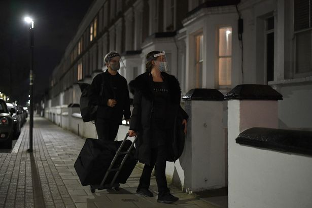 Secret Spa hair stylist Nas Ganev (left) and tan artist Magdelaine Gibson arrive for a midnight spa