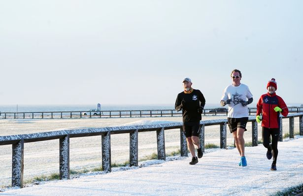 People take exercise in a light dusting of overnight snow