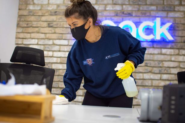 Woman cleaning an office