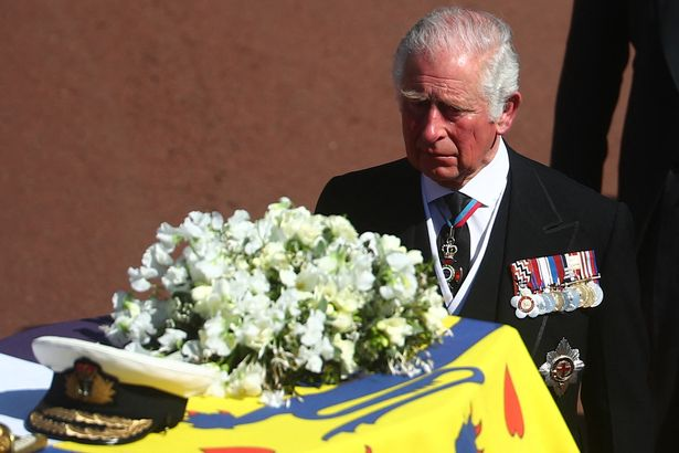 Prince Charles walks behind the coffin of Prince Philip
