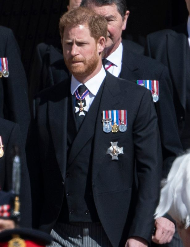Prince Harry walks behind Prince Philip's coffin at Saturday's funeral