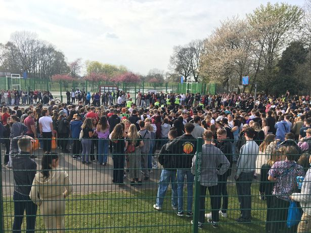 Police and large crowds have been pictured at a park in Fallowfield