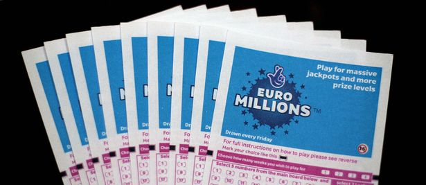 Lottery tickets for the EuroMillions jackpot are displayed in central London