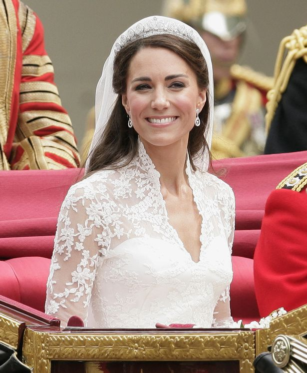 Catherine, Duchess of Cambridge travels down The Mall on route to Buckingham Palace in a horse drawn carriage following her wedding at Westminster Abbey on April 29, 2011 in London, England
