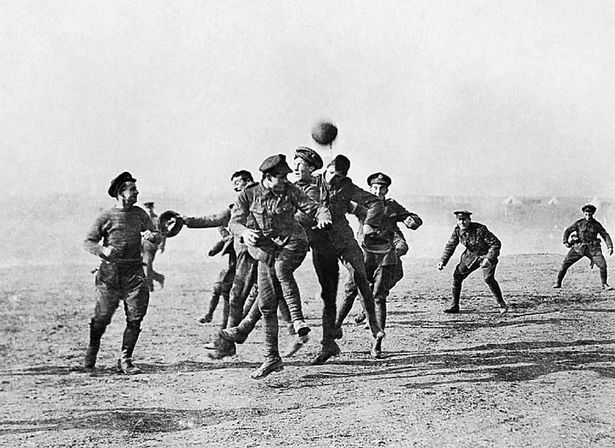 Soldiers play football in No-Man's Land during the Christmas Truce during World War One