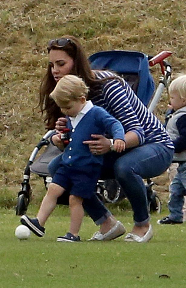 The Duchess of Cambridge pictured with Prince George