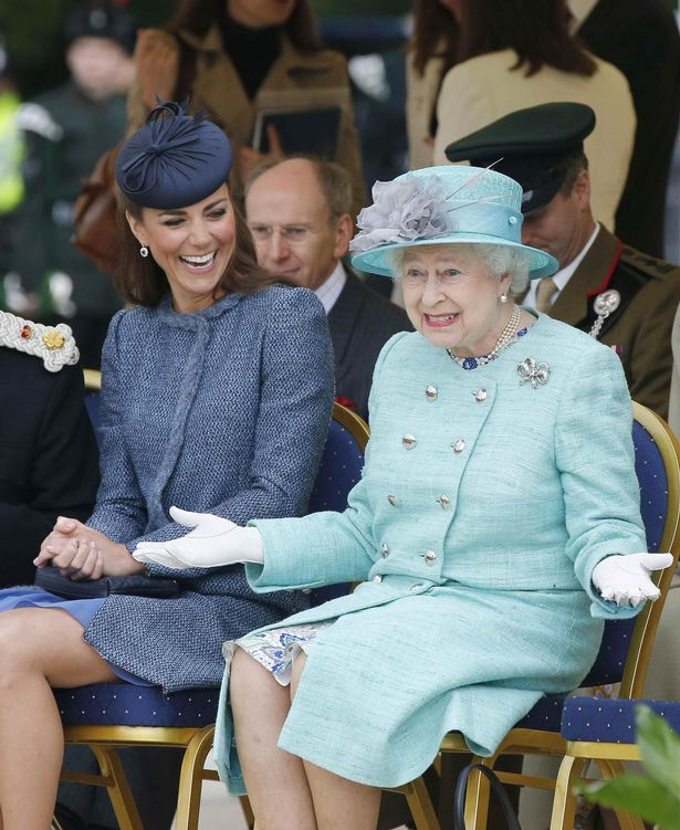 The Duchess of Cambridge pictured laughing as Queen Elizabeth II gestures while they watch part of a children's sports event during a visit to Vernon Park in Nottingham