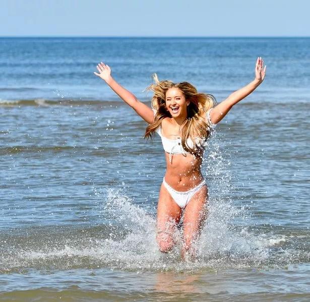 Dancer Lydia Blyth enjoys the hot weather on St Annes Beach, Lancs