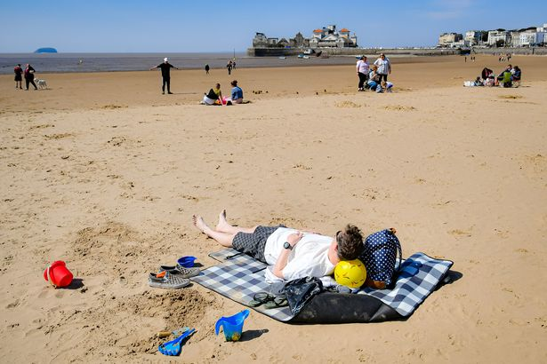 People on the beach in Weston-super-Mare, Somerset