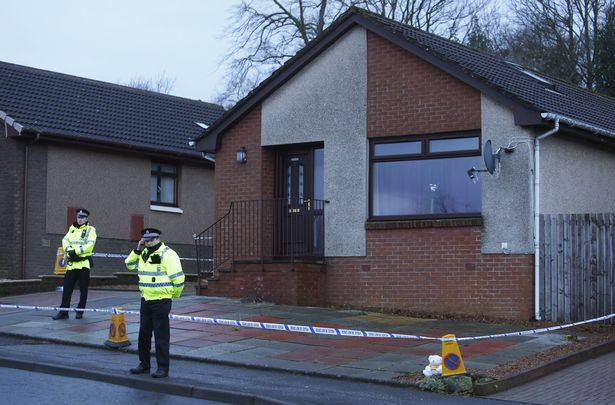 Police outside the house in Kirkcaldy, Scotland after the child's body was found