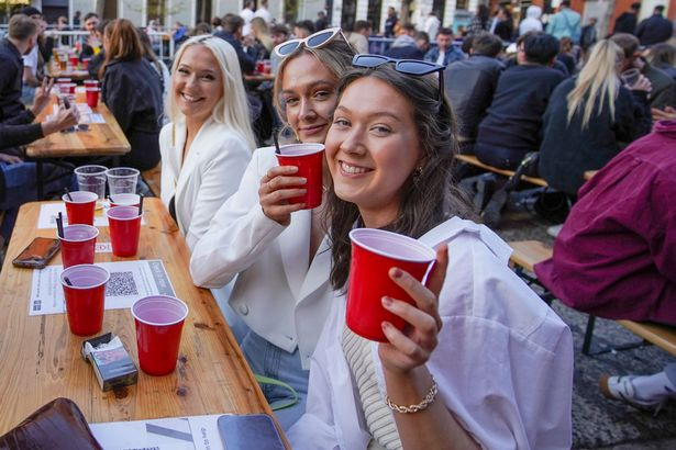 Drinkers soaked up the warm weather outside bars in Manchester