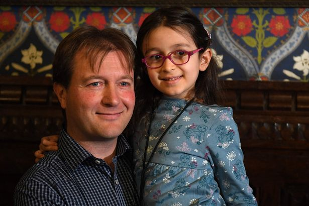 Richard Ratcliffe, husband of British-Iranian aid worker Nazanin Zaghari-Ratcliffe jailed in Tehran since 2016, holds his daughter Gabriella during a news conference in London