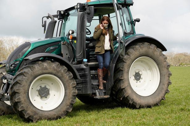 The Duchess of Cambridge on a tractor during the visit