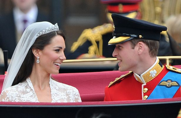Newlyweds Kate and William during their carriage procession to Buckingham Palace