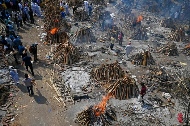 Burning funeral pyres can be seen of the patients who died of the Covid-19 coronavirus at a crematorium in New Delhi