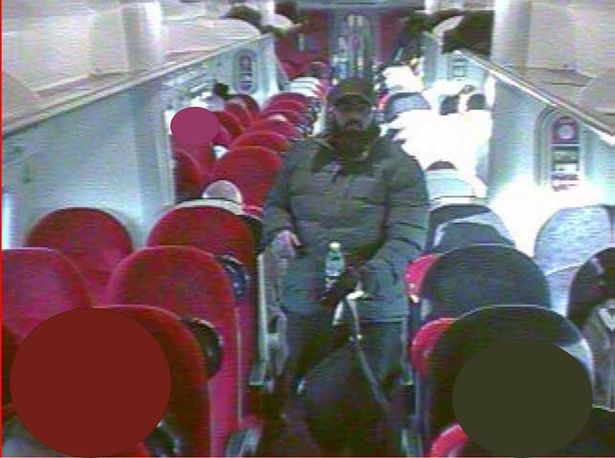 CCTV grab of Usman Khan on board a train to London, which was shown in court at the inquest