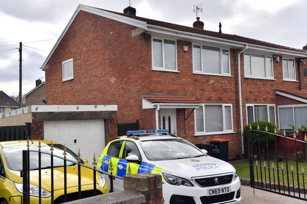 A police car parked outside the home where Kerry Bradford's body was discovered